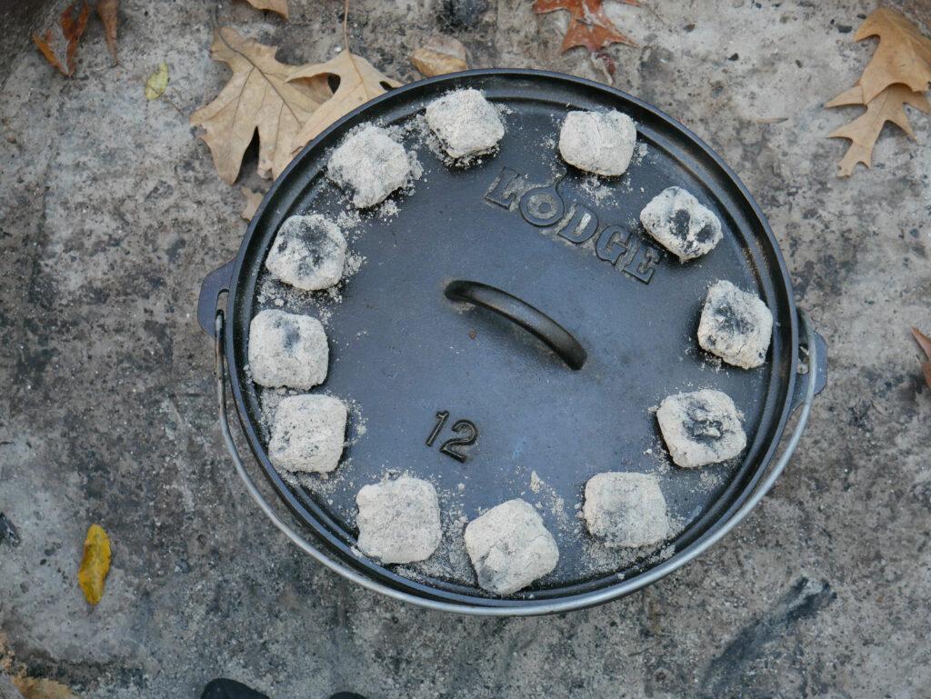 dutch oven cobbler baking with coals