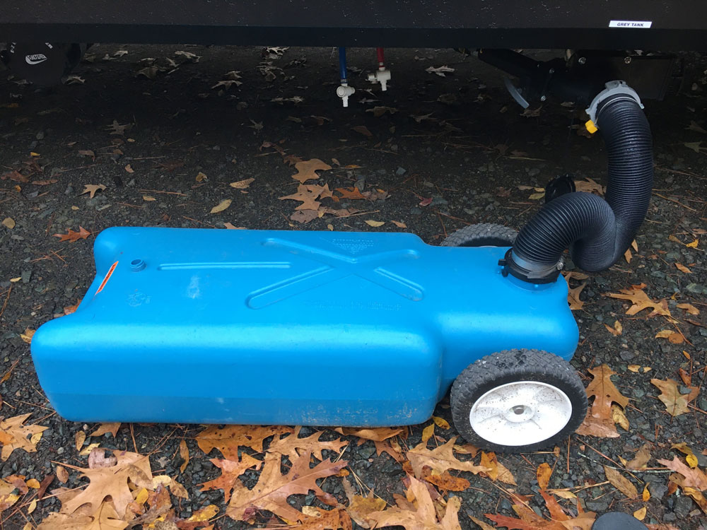 RV Tote Tank Connected To Camper Sewer Hookup