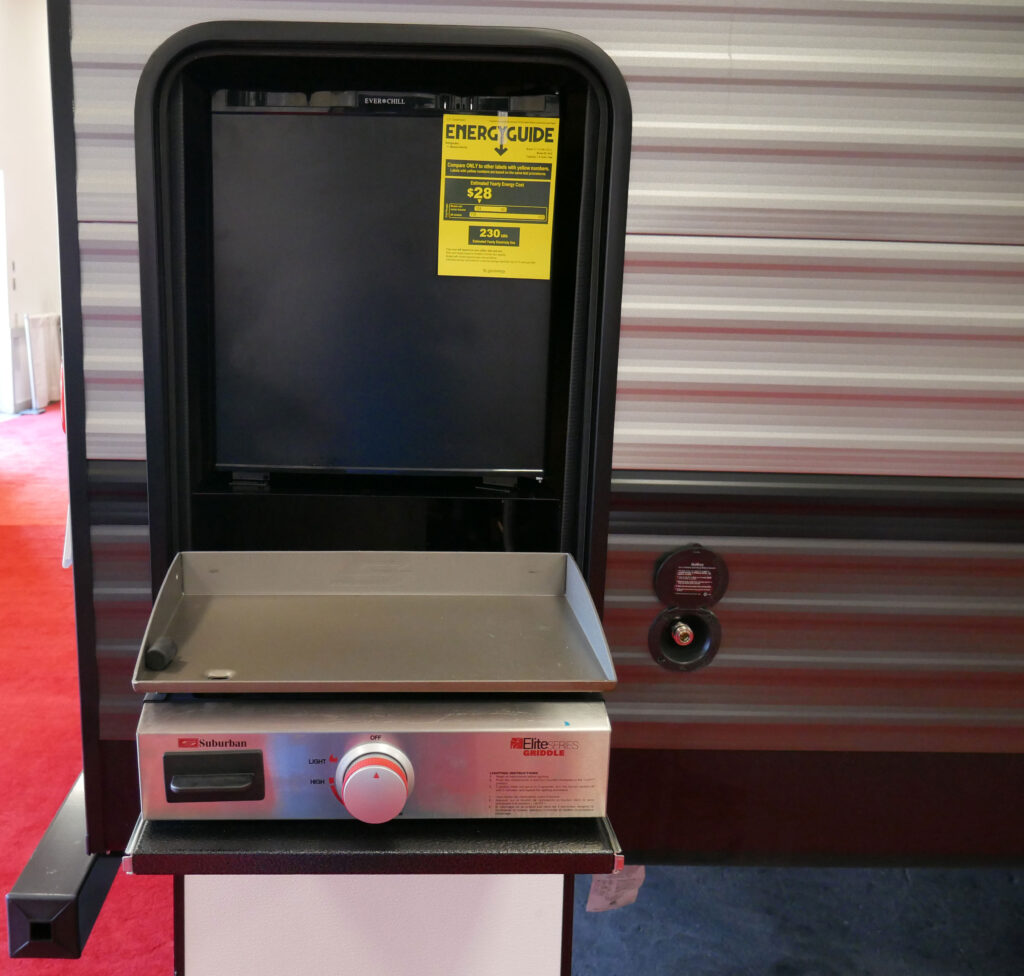 Small RV Camper Outside Kitchen With Griddle On Display At Richmond RV Show 2020