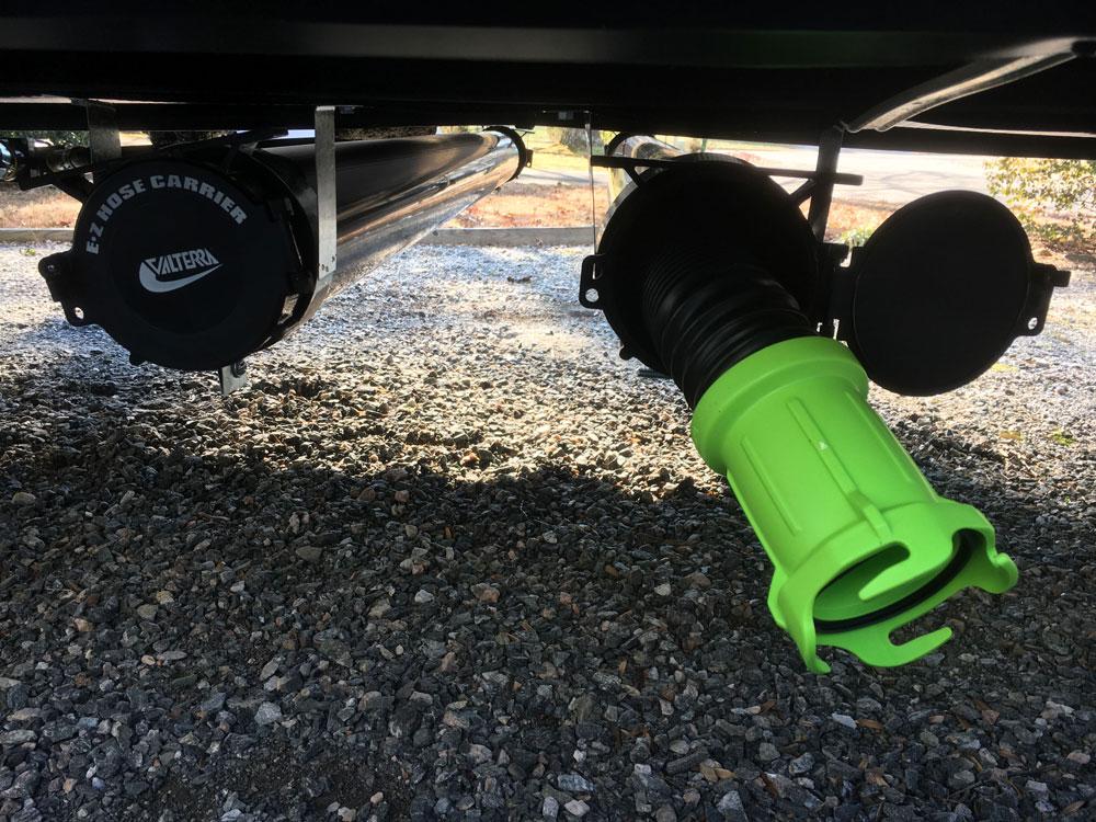 Thetford Camper Sewer Hoses Shown in  Valterra Sewer Hose Storage Tube Mounted Under RV Camper