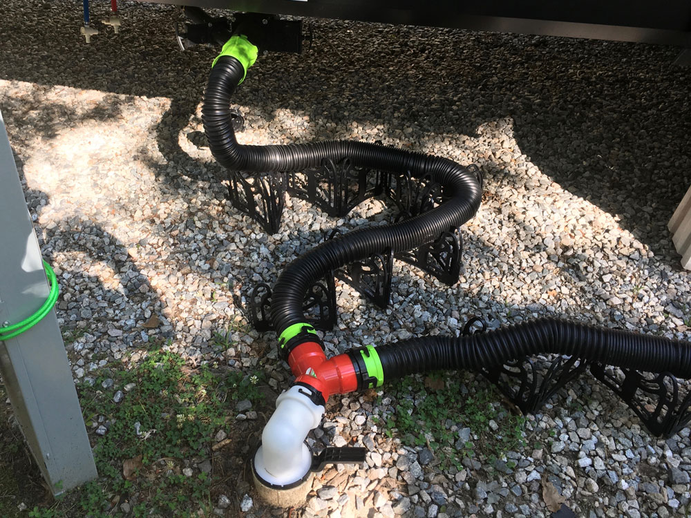 Two Thetford Titan RV Sewer Hoses Connected to Valterra Wye Showing Need for Shorter Sewer Hose