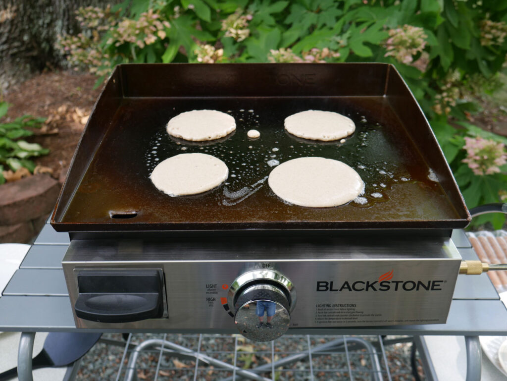 blackstone griddle with four pancakes