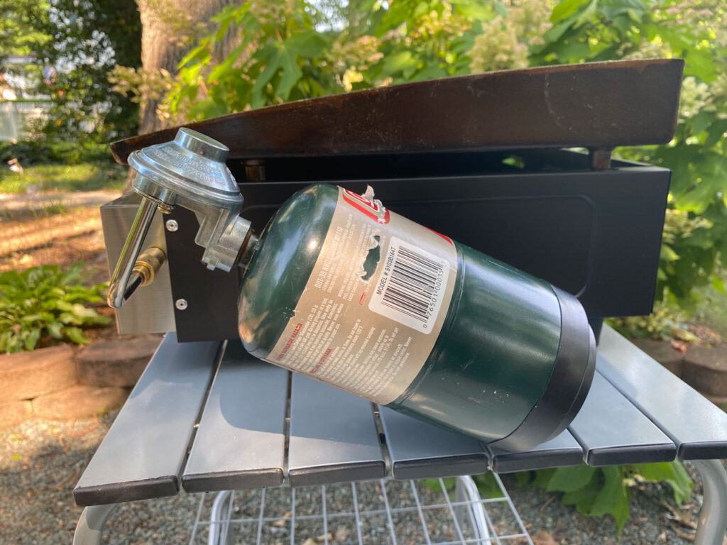Blackstone Griddle shown with small green propane cylinder in Blackstone griddle review