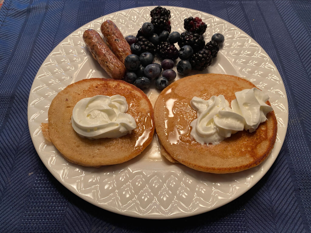 pancakes sausage breakfast cooked on a blackstone griddle