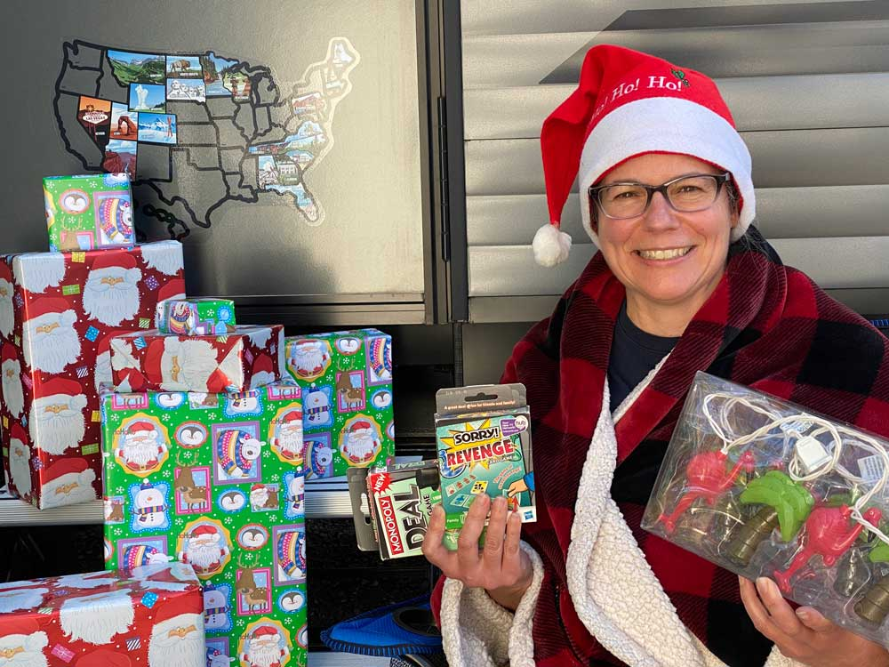 Woman Ready to Give RV Camper Gifts