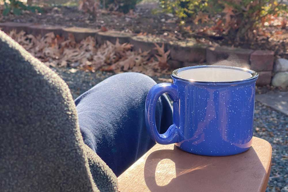 Enjoying a Mug of  Camping Coffee on a Cool Day