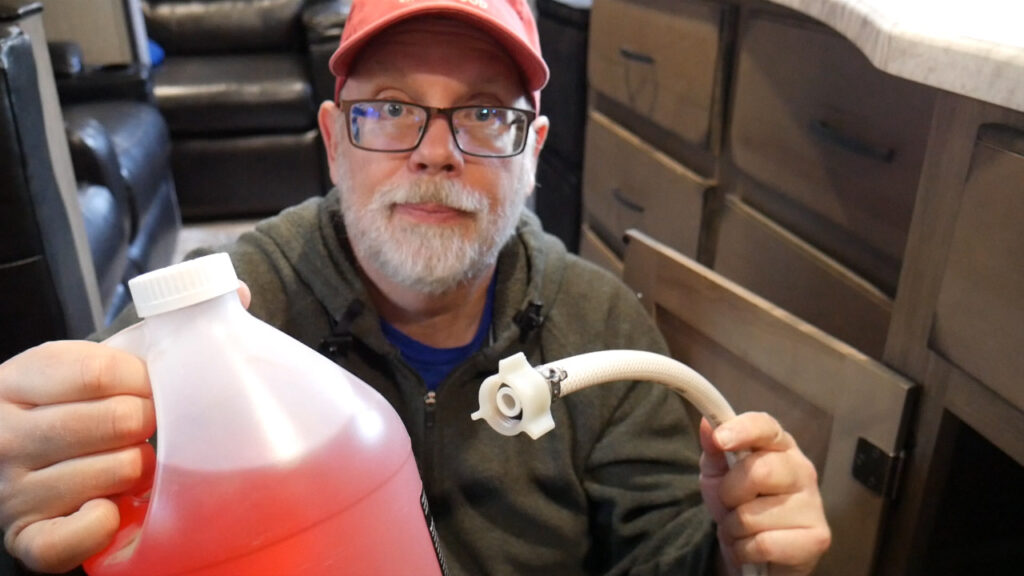 Draw Antifreeze Into the System Using The Winterization Hose