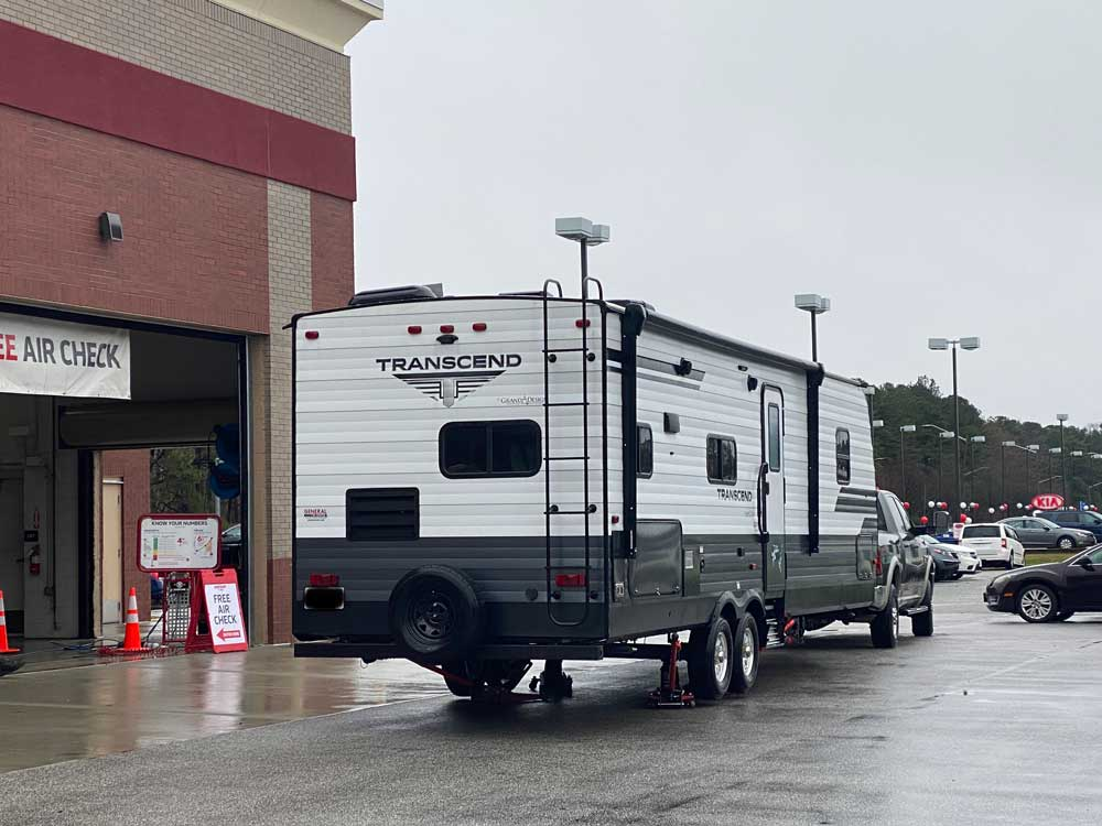 Travel Trailer Parked At Tire Shop For New Trailer Tires