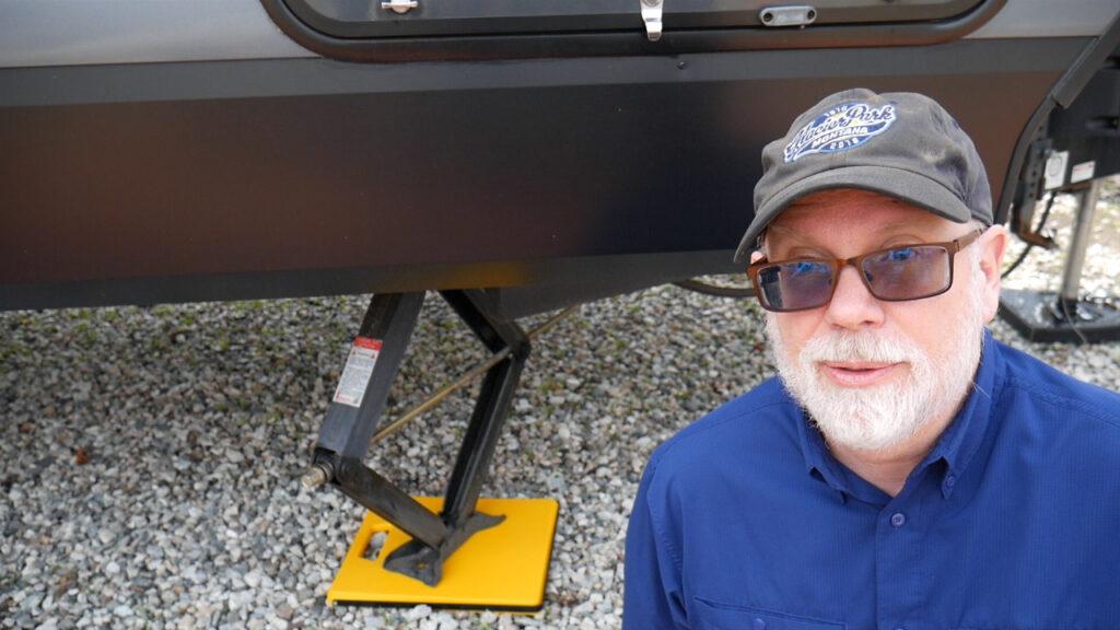 Camco stabilizer pad installed under travel trailer jack