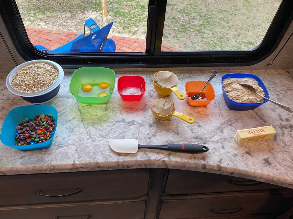 RV Baking Monster Cookies Ingredients Spread on Travel Trailer Counter