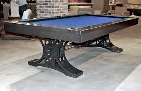 A new pool table with blue felt for sale in the North Coast Pool Tables showroom