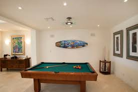 A game room pool table about to be moved by North Coast Pool Tables