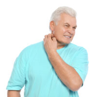 Mature man scratching neck on white background. Annoying itch