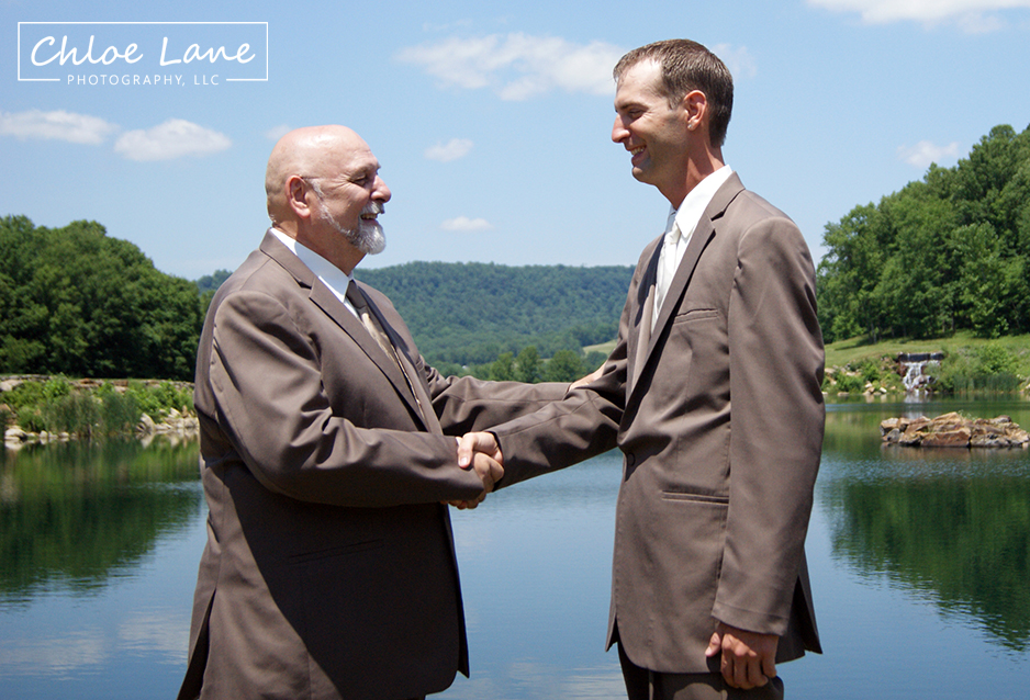 Groom shaking hands with his dad after wedding ceremony near Latrobe, PA