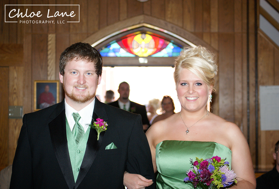 Bridesmaid and Groomsman walking down the aisle during wedding ceremony in Latrobe