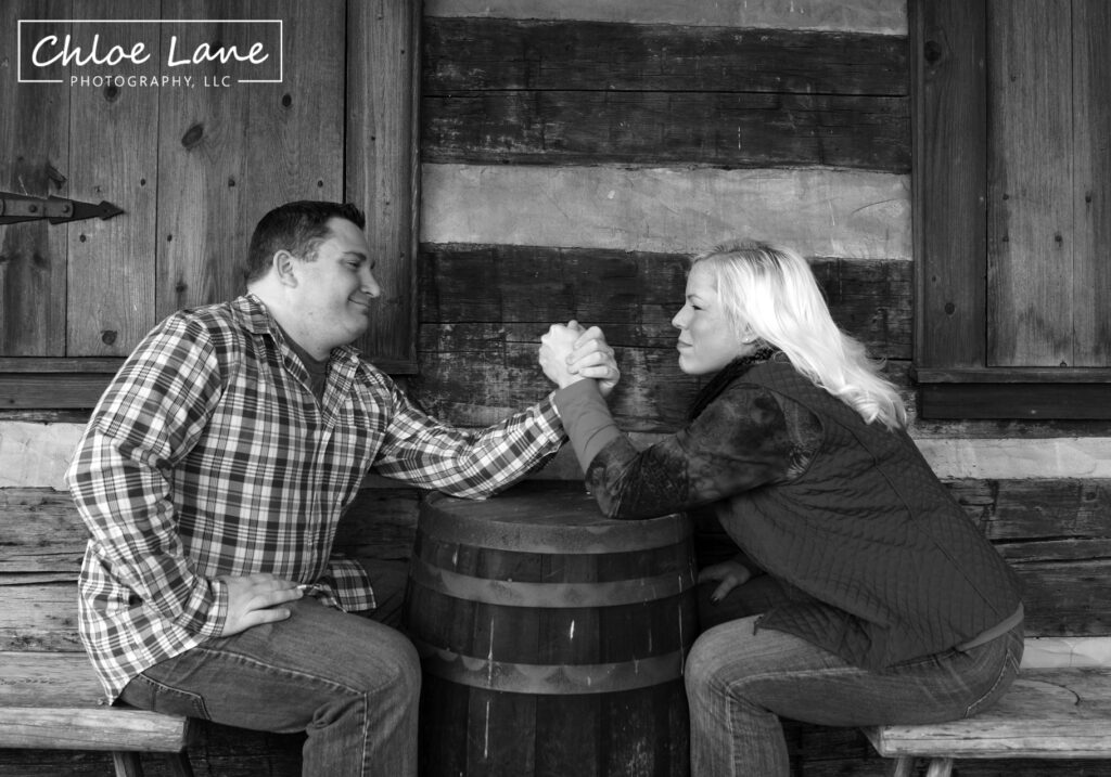 Funny arm wrestling engagement photos at Historic Hanna's Town in Greensburg, PA