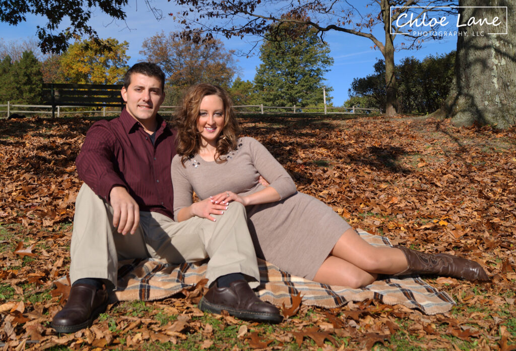 Early autumn Engagement Photos sitting on blanket in field at Hartwood Acres mansion in Pittsburgh, PA