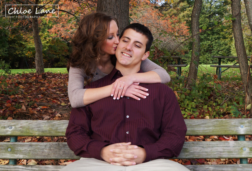 Early autumn Engagement Photos at sitting on bench at Hartwood Acres mansion in Pittsburgh, PA