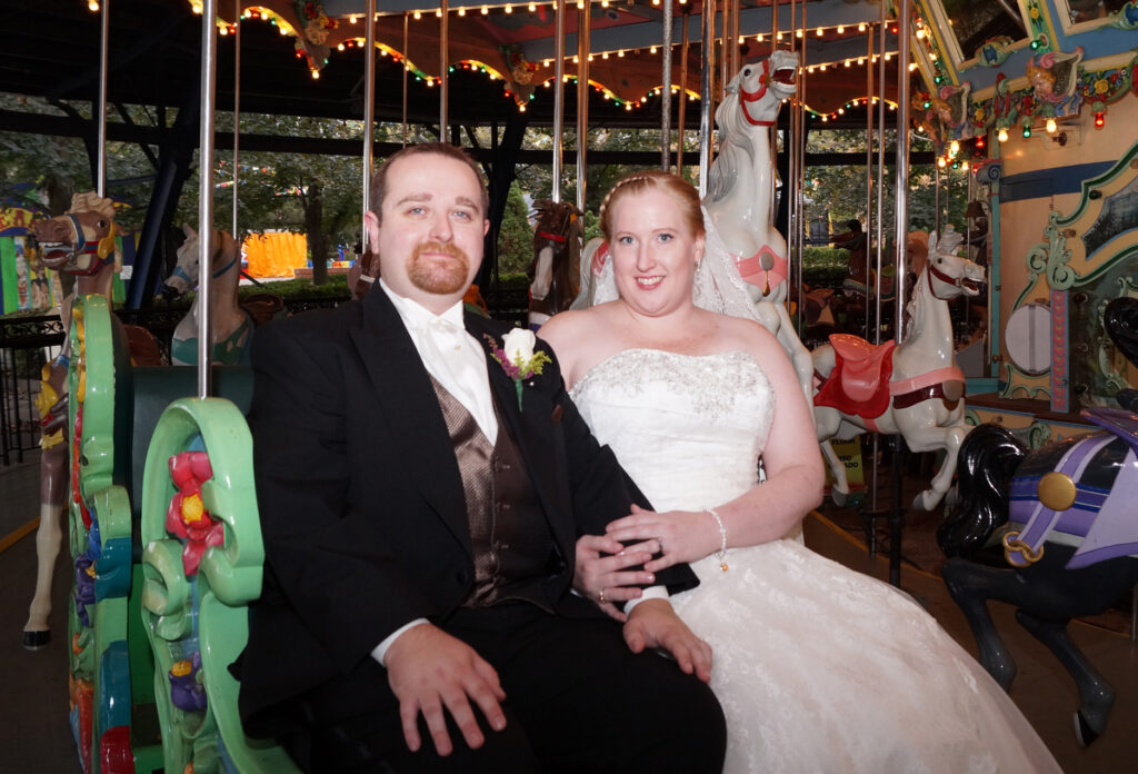 Bride and groom on the carousel at Kennywood Park in Pittsburgh, PA