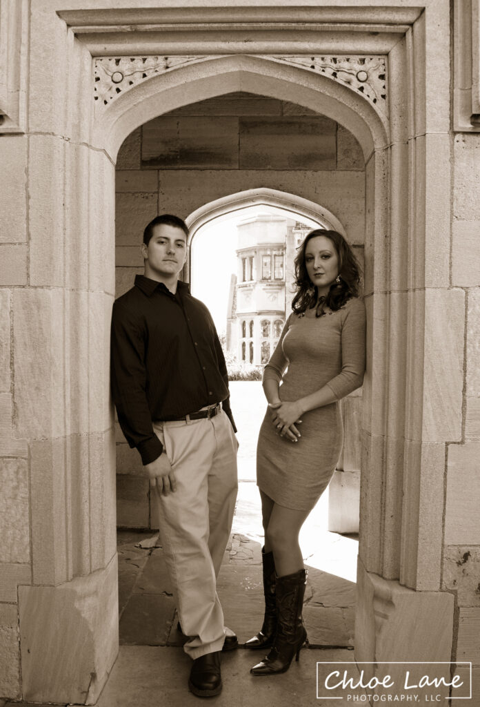 Early autumn Engagement Photos standing in archway at Hartwood Acres mansion in Pittsburgh, PA