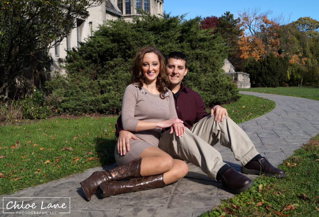 Engagement Photo sitting on the walkway at Hartwood Acres mansion in Pittsburgh, PA