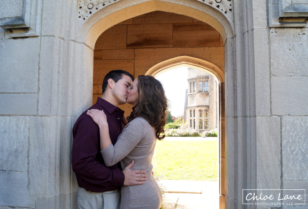 Engagement Photos standing in archway at Hartwood Acres mansion in Pittsburgh, PA