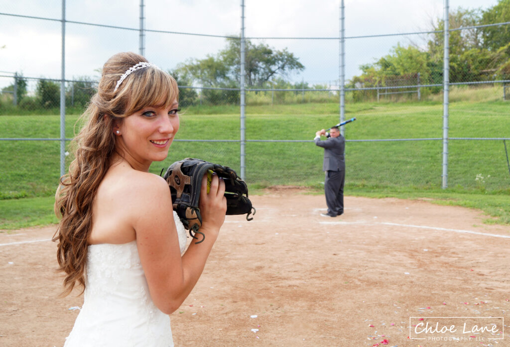 Softball wedding theme, bride pitching softball to her husband in Scottdale Pennsylvania