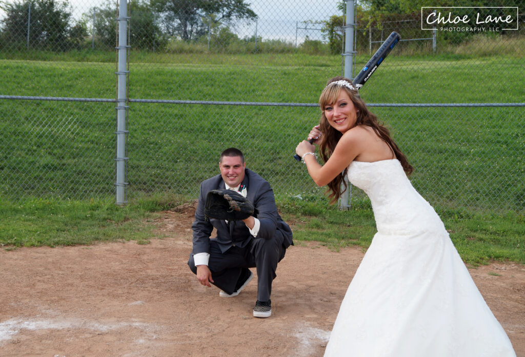 Softball wedding theme, groom pitching softball to his new bride in Scottdale Pennsylvania