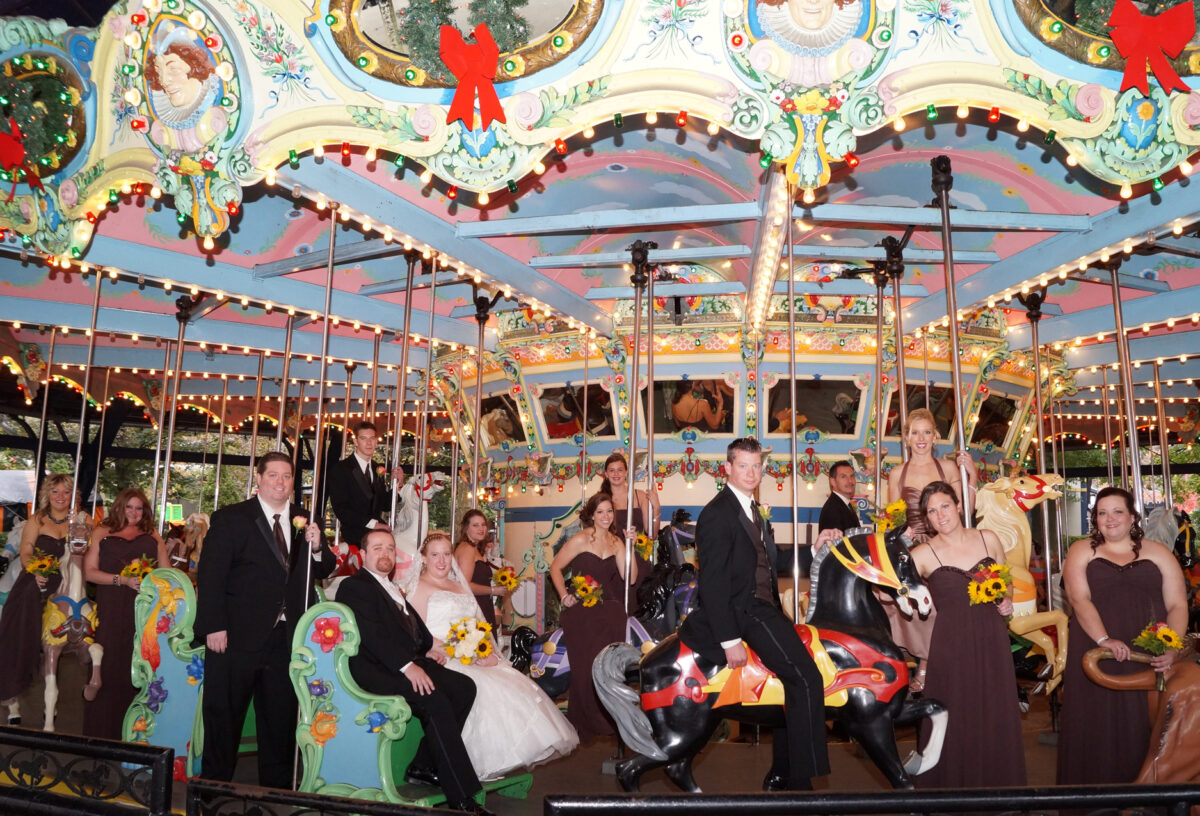 Wedding-party-on-carousel-at-Kennywood-Park-Pittsburgh by Chloe Lane Photography Greensburg and Latrobe