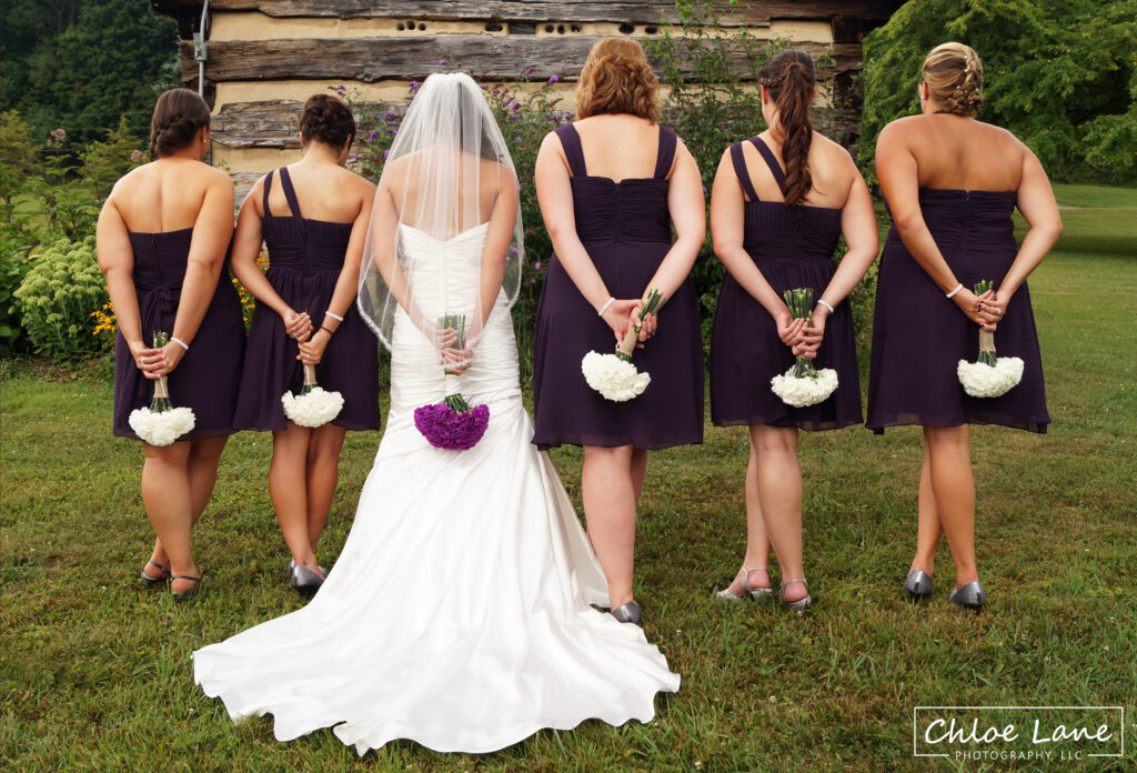 Bridal-party-with-boquets-outside-chapel-at-Foggy-Mountain-Lodge