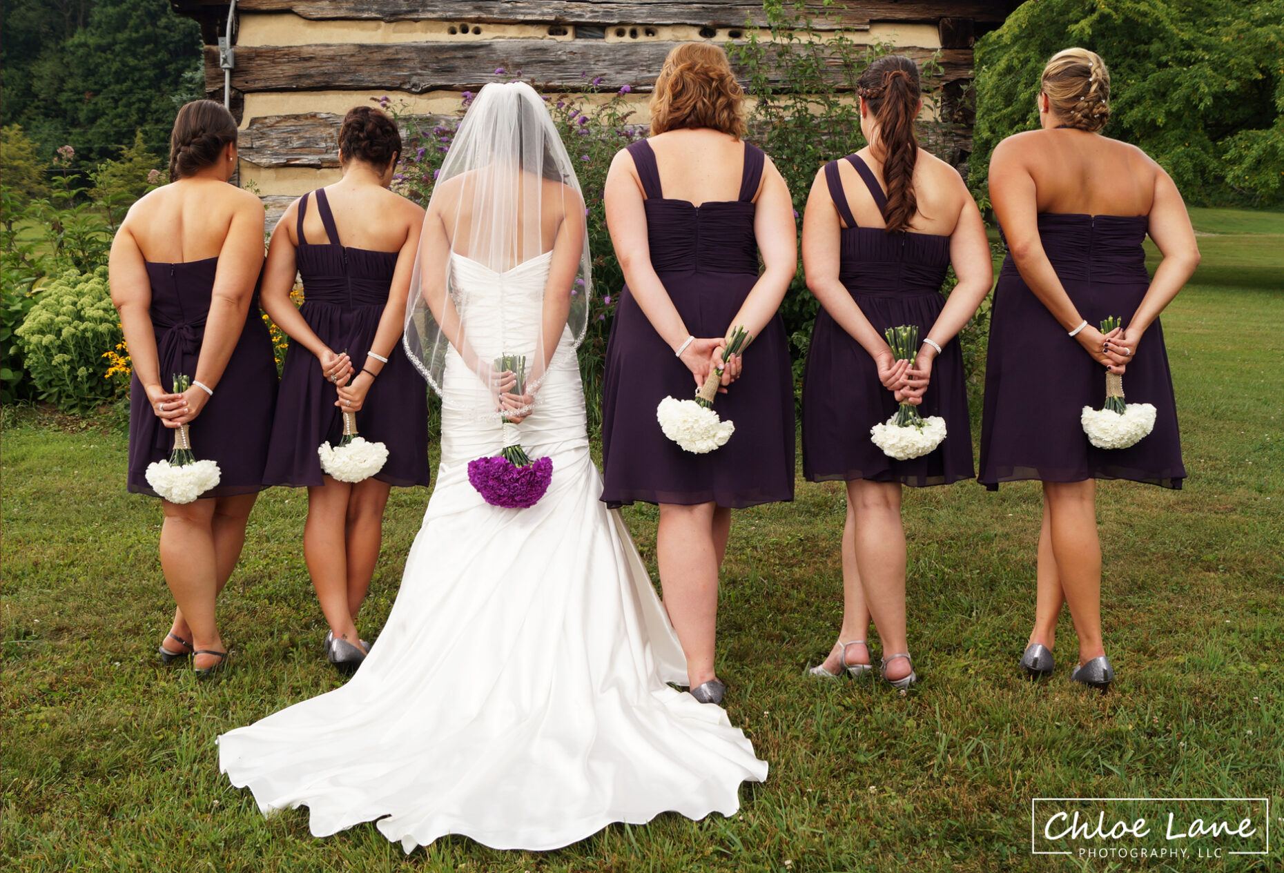 Bridal-party-with-boquets-outside-chapel-at-Foggy-Mountain-Lodge by Chloe Lane Photography Latrobe and Greensburg PA
