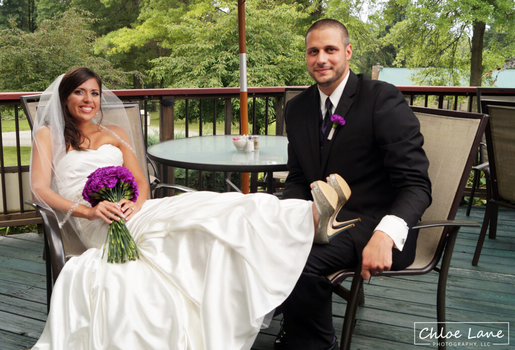 Bride-and-Groom-relaxing-on-patio-during-wedding-reception-Foggy-Mountain-Lodge