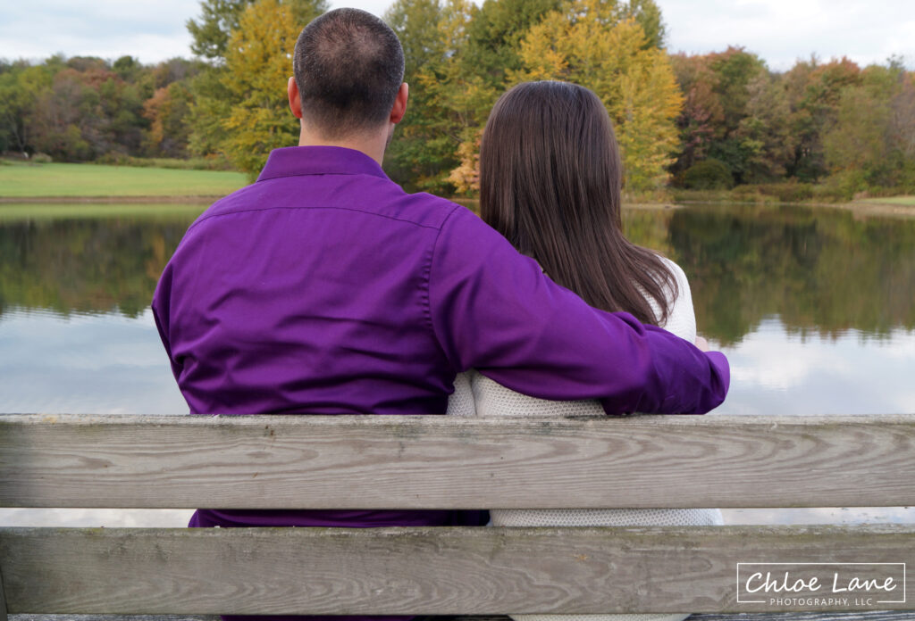 Engagement-Photo-Sitting-on-Bench-lakefront-at-Foggy_Mountain-Lodge by Chloe Lane Photography Latrobe and Greensburg PA