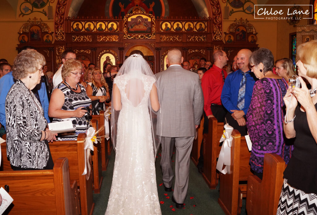Bride-and-father-walking-down-aisle-at-St-Marys-Church-Latrobe-Pennsylvania