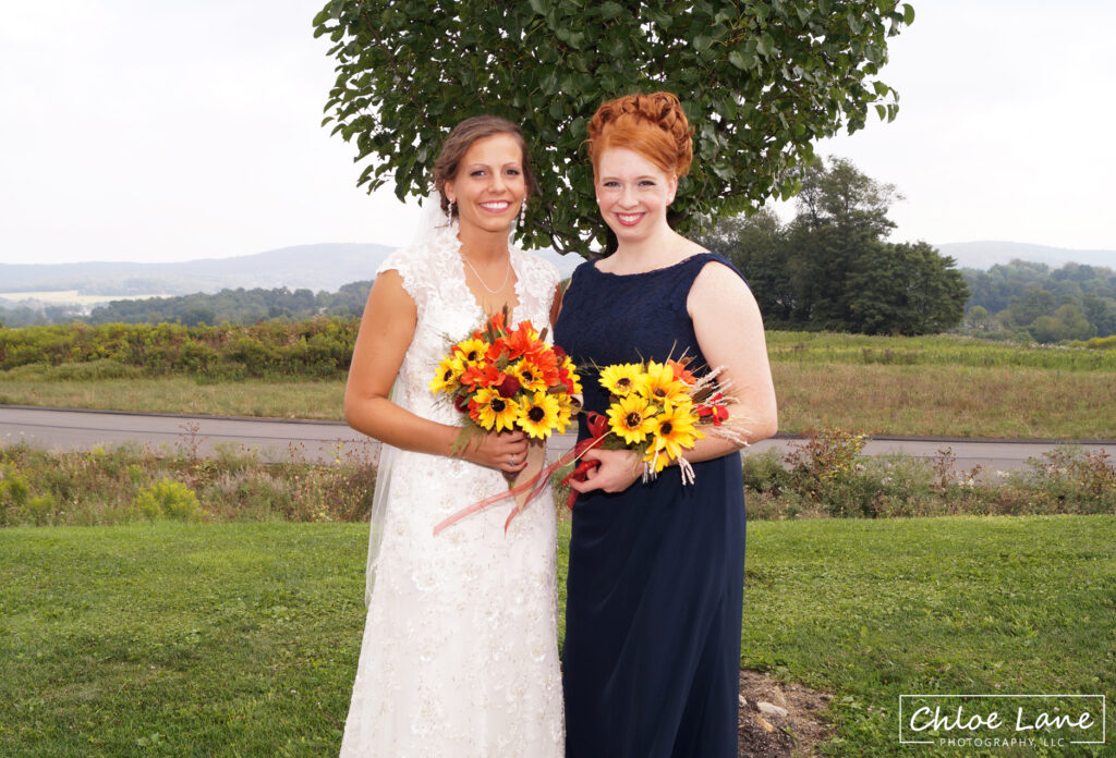 Bride-and-maid-of-honor-before-wedding-outside-Springhill-Suites-Latrobe-PA