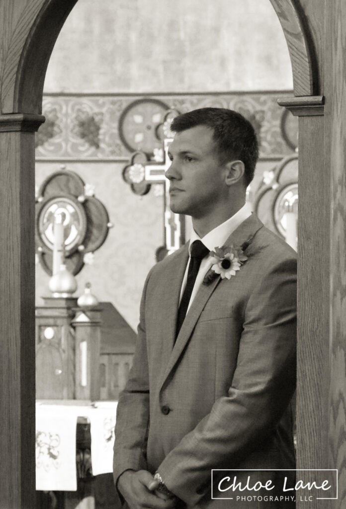groom-watching-bride-come-down-aisle-St-Marys-Church-Latrobe-Pennsylvania