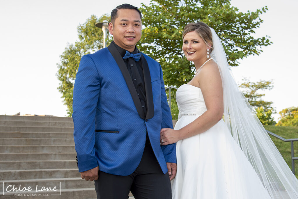 Bride and groom posing on the stairs near Heinz Field Pittsburgh wedding photographs