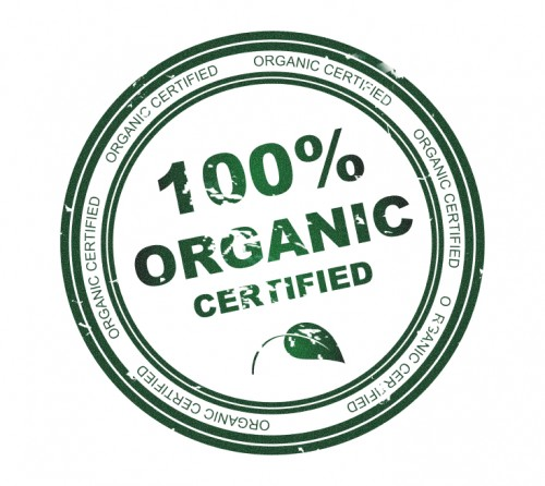 Round stamp with text 100% Organic