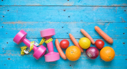 Dumbbells and healthy food, fitness and dieting, free copy space
