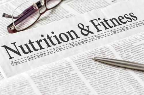 A newspaper with the headline Nutrition and Ftitness