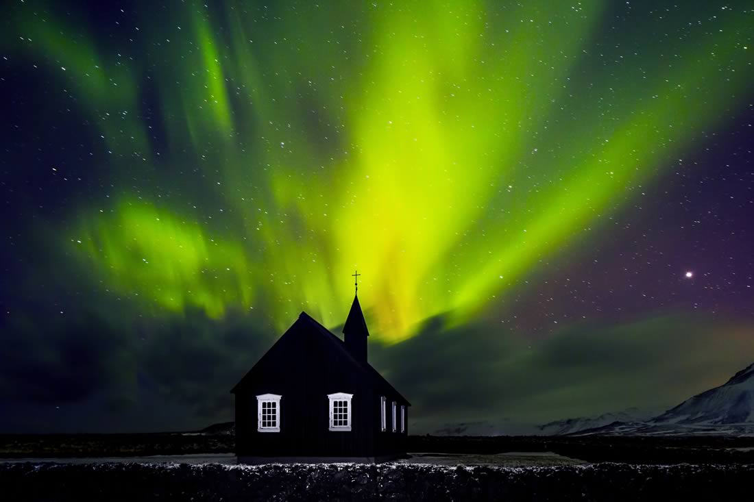 Northern Lights Dance Above Church Steeple