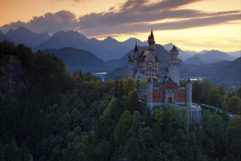 Beautiful evening view of the fairy tale Neuschwanstein castle, with autumn colors during sunset in Bavaria