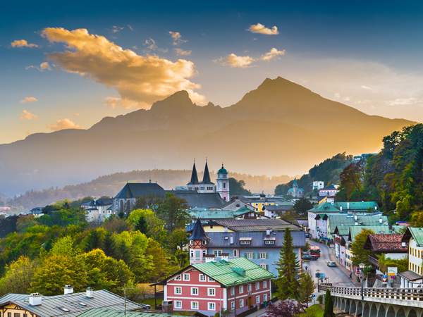 Mountain village of Berchtesgaden with Watzmann mountain silhouette in the background at sunset, Nationalpark Berchtesgadener Land, Bavaria, Germany