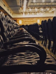 tufted black chairs inside building with no people