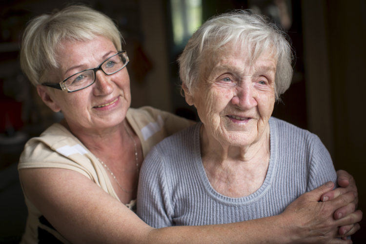 An elderly woman with her adult daughter.