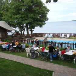 Picnic area and outdoor pool at Adventure North Resort