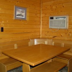 Dining room in the evergreen cabin at Adventure North Resort