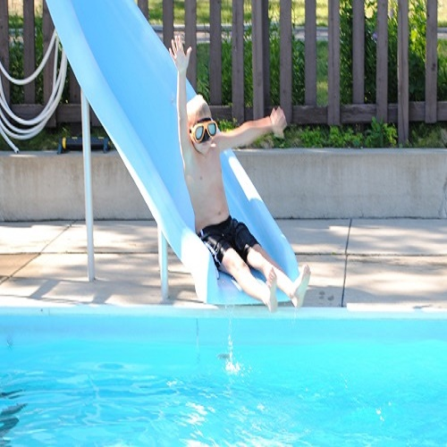Enjoy the water slide with your family at Adventure North Resort