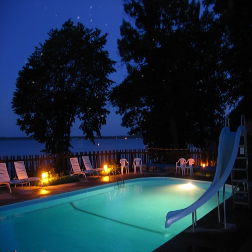 Take a nighttime dip into our in-ground pool and feel the stress melt away.