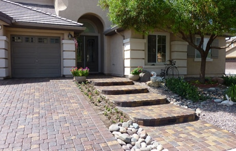 paver driveway and matching sidewalk and stairs entryway